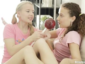 Teens Lick A Huge Lollipop And Perky Titties